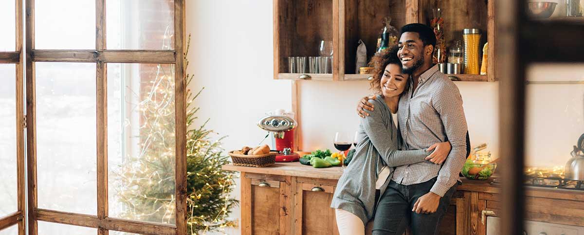 Happy couple enjoying remodeled home